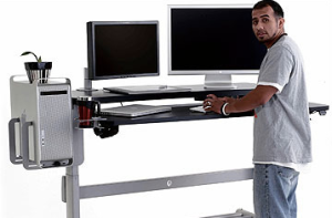 A Sit-Stand Desk May Raise Levels Of Productivity At Work